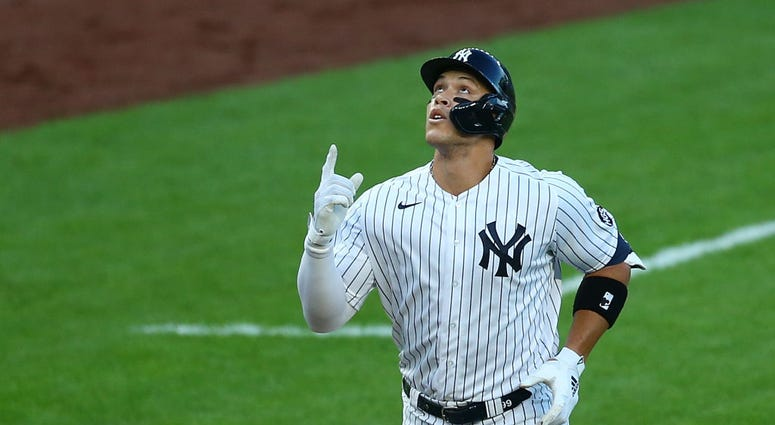 Aaron Judge celebrates a homer vs. the Red Sox.