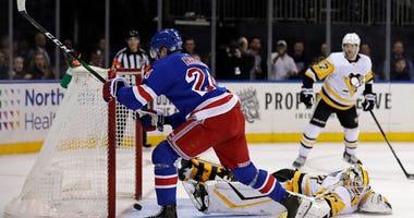 Rangers right wing Kaapo Kakko scores the game-winning goal past Penguins goaltender Matt Murray during overtime on Nov. 12, 2019, at Madison Square Garden.