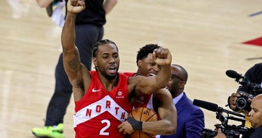 The Raptors' Kawhi Leonard (2) and Kyle Lowry celebrate winning the NBA championship over the Golden State Warriors after Game 6 of the NBA Finals on June 13, 2019, at Oracle Arena in Oakland, California.