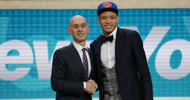 Kevin Knox poses with NBA commissioner just after Knox was drafted by the Knicks on June 21, 2018.
