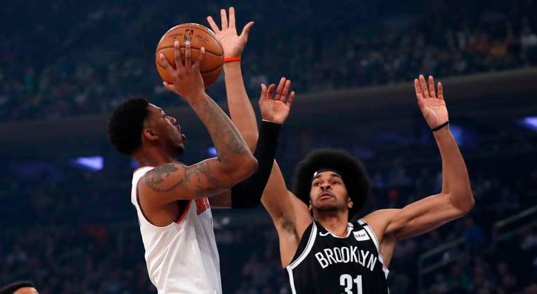 Knicks guard Elfrid Payton moves to the basket against Nets center Jarrett Allen on Jan. 26, 2019, at Madison Square Garden.
