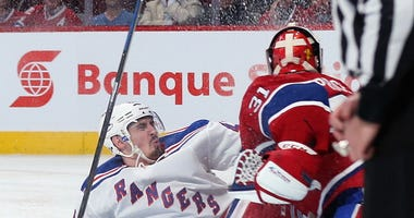 Chris Kreider crashes into Canadiens goalie Carey Price
