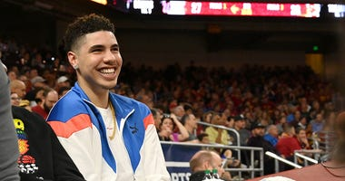 LaMelo Ball watches a USC-UCLA game.