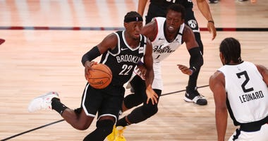 Caris LeVert drives to the hoop for the Nets.