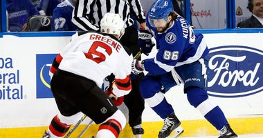 The Lightning's Nikita Kucherov skates with the puck as Devils defenseman Andy Greene (6) defends during Game 2 of their first-round playoff series on April 14, 2018, at Amalie Arena in Tampa, Florida.
