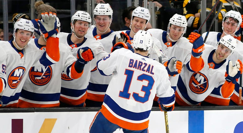 Islanders center Mathew Barzal celebrates with teammates after scoring a goal against the Bruins during a shootout on Dec. 19, 2019, at TD Garden in Boston.