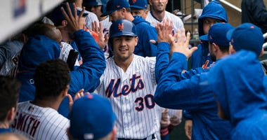 Teammates congratulate Mets outfielder Michael Conforto after he hit a three-run homer against the Philadelphia Phillies on Sept. 9, 2018, at Citi Field.