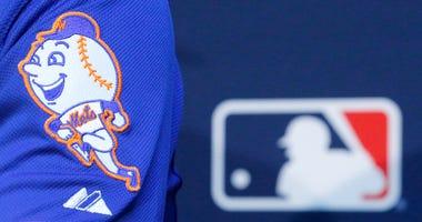 MLB logo inside Mets dugout