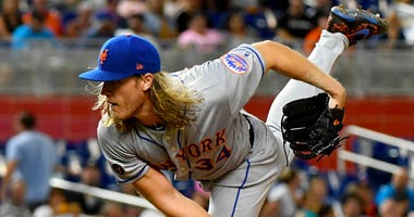 The Mets' Noah Syndergaard delivers a pitch against the Miami Marlins  on April 9, 2018, at Marlins Park in Miami.