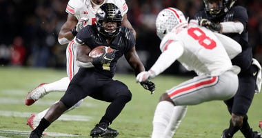 Purdue running back D.J. Knox (1) cuts in front of Ohio State cornerback Kendall Sheffield (8) during the first half of an NCAA college football game in West Lafayette, Ind., Saturday, Oct. 20, 2018.