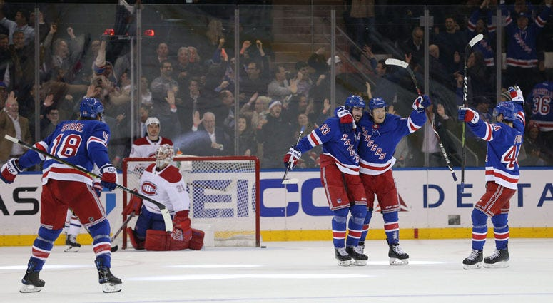 Rangers center Mika Zibanejad (93) celebrates his goal against the Montreal Canadiens with teammates on Nov. 6, 2018, at Madison Square Garden.