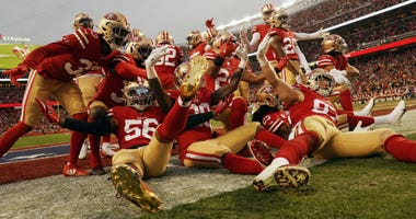 The San Francisco 49ers defense celebrates after an interception by Emmanuel Moseley in the first half against the Green Bay Packers during the NFC Championship game at Levi's Stadium on January 19, 2020 in Santa Clara, California.