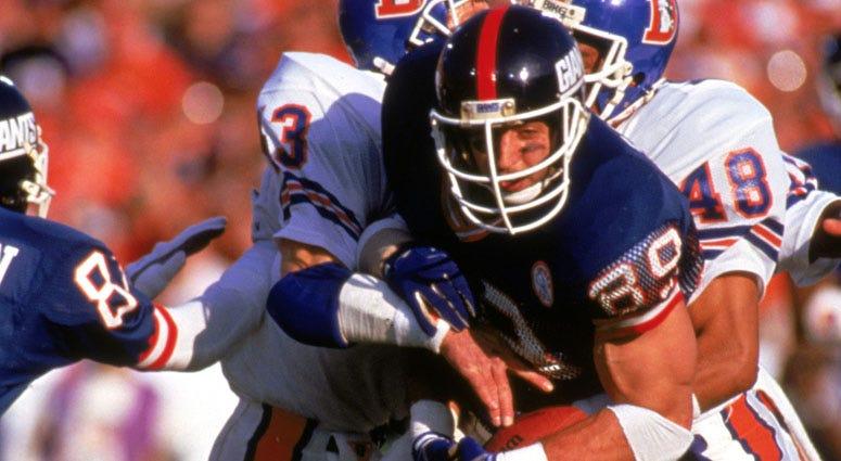 Giants tight end Mark Bavaro fights for yardage against the Denver Broncos during Super Bowl XXI.