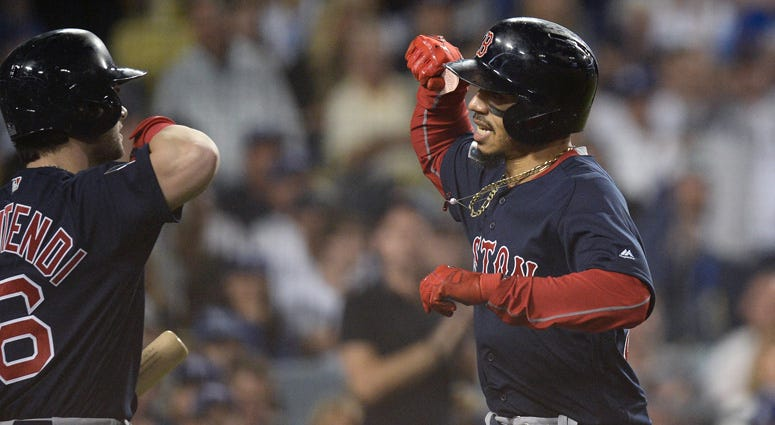Red Sox outfielder Mookie Betts celebrates with teammate Andrew Benintendi after hitting a solo home run in the sixth inning against the Dodgers in Game 5 of the 2018 World Series at Dodger Stadium in Los Angeles.