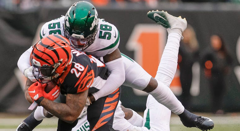 James Burgess of the Jets makes the tackle on Joe Mixon of the Cincinnati Bengals at Paul Brown Stadium on Dec. 1, 2019,  in Cincinnati, Ohio.