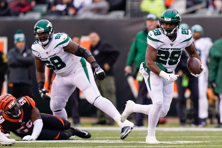 Bilal Powell of the Jets runs with the ball during the first half of NFL football game against the Cincinnati Bengals at Paul Brown Stadium on December 1, 2019 in Cincinnati, Ohio.