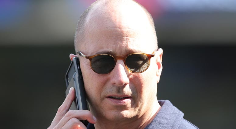 Yankees general manager Brian Cashman speaks on his phone during a workout day before Game 1 of the AL Division Series at Yankees Stadium on Oct. 2, 2019.