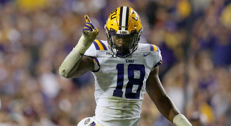 LSU linebacker K'Lavon Chaisson gestures after a play against Texas A&M on Nov. 30, 2019, at Tiger Stadium in Baton Rouge, Louisiana.