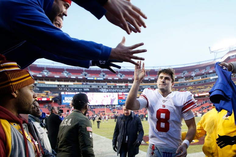 Landover, Maryland, USA; Giants quarterback Daniel Jones celebrates with fans while leaving the field after the Giants game against the Redskins at FedExField on Dec 22, 2019.