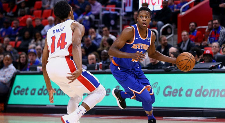 The Knicks' Frank Ntilikina is guarded by the Pistons' Ish Smith on Dec. 29, 2017, at Little Caesars Arena in Detroit.