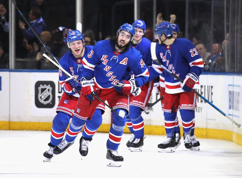 The laces on the Rangers' hallmark collar can be seen hanging from Mike Zibanejad's uniform.