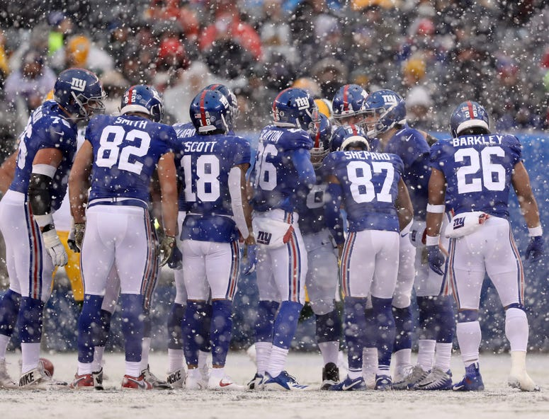The Giants huddle.