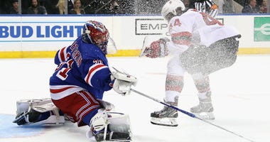 The Rangers' Igor Shesterkin makes a save on Miles Wood of the Devils on Sept. 18, 2019, at Madison Square Garden.