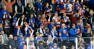 Fans react after the Islanders defeat the Buffalo Sabres on Dec. 14, 2019, at Nassau Veterans Memorial Coliseum in Uniondale.