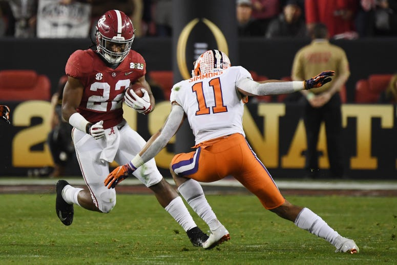 Najee Harris of the Alabama Crimson Tide runs against Isaiah Simmons of the Clemson Tigers in the CFP National Championship presented by AT&T at Levi's Stadium on January 7, 2019 in Santa Clara, California.