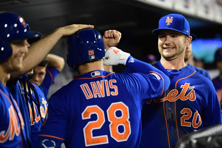 Pete Alonso congratulates J.D. Davis of the Mets after his home run in the fourth inning of their game against the Atlanta Braves at Citi Field on September 27, 2019.