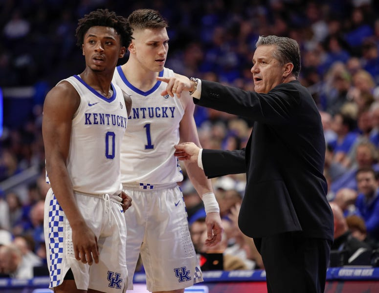 Ashton Hagans and Nate Sestina of the Kentucky Wildcats talk with head coach John Calipari of the during the second half against the Mississippi State Bulldogs at Rupp Arena on February 4, 2020 in Lexington, Kentucky.