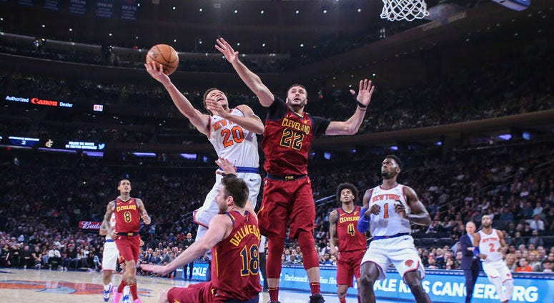 Knicks forward Kevin Knox drives past Cleveland Cavaliers forward Larry Nance Jr. (22) and guard Matthew Dellavedova on Nov. 10, 2019, at Madison Square Garden.
