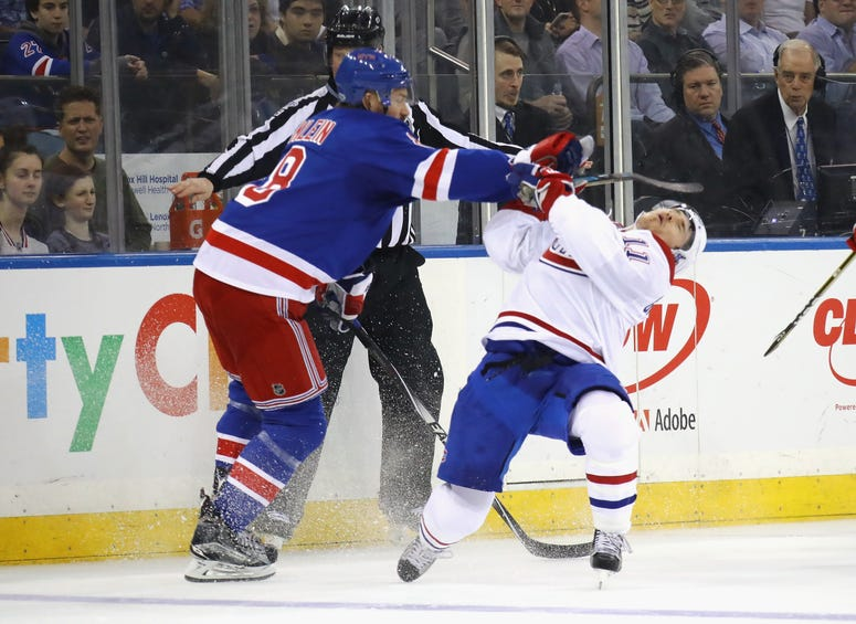 Kevin Klein of the Rangers hits Brendan Gallagher of the Montreal Canadiens during the first period in Game Three of the Eastern Conference First Round during the 2017 NHL Stanley Cup Playoffs at Madison Square Garden on April 16, 2017 in New York City.