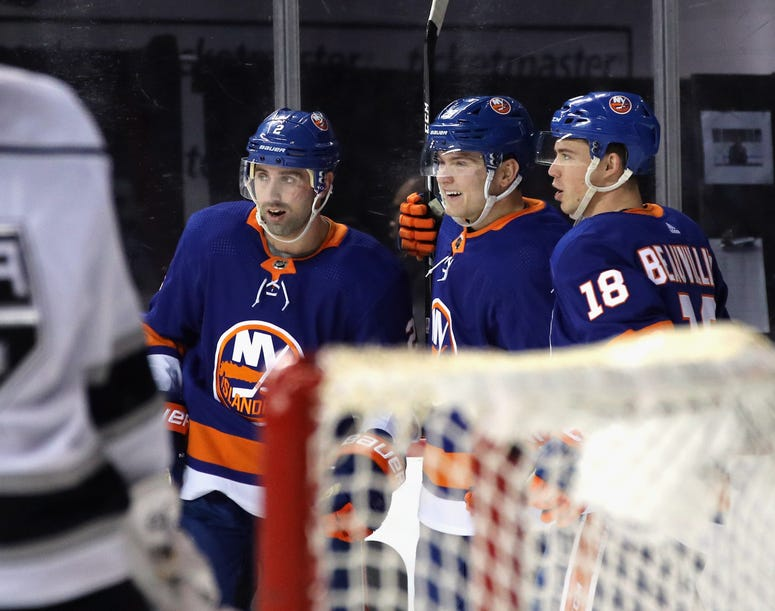 Kieffer Bellows of the Islanders celebrates his first NHL goal against the Los Angeles Kings at 10:22 of the second period and is joined by Nick Leddy and Anthony Beauvillier at the Barclays Center on February 06, 2020.