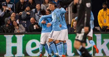 NYCFC's Maximiliano Moralez (10) and teammates celebrate after a goal against Sporting Kansas City on March 4, 2018, at Children's Mercy Park in Kansas City, Kansas.