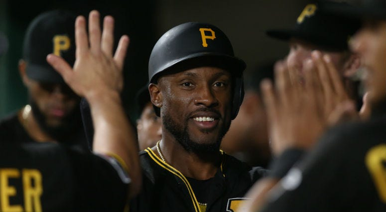Sep 6, 2019; Pittsburgh, PA, USA; Pittsburgh Pirates center fielder Starling Marte (6) high-fives in the dugout after scoring a run against the St. Louis Cardinals during the seventh inning at PNC Park