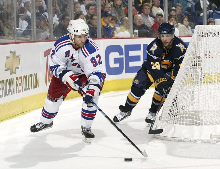 Michael Nylander of the Rangers controls the puck as Jason Pominville #29 of the Buffalo Sabres defends during Game 1 of the 2007 Eastern Conference Semifinal game on April 25, 2007 at HSBC Arena in Buffalo, New York.