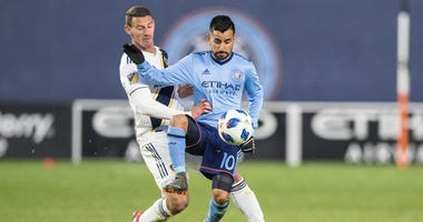 New York City midfielder Maximiliano Moralez controls the ball against the LA Galaxy's Perry Kitchen on March 11, 2018, at Yankee Stadium.