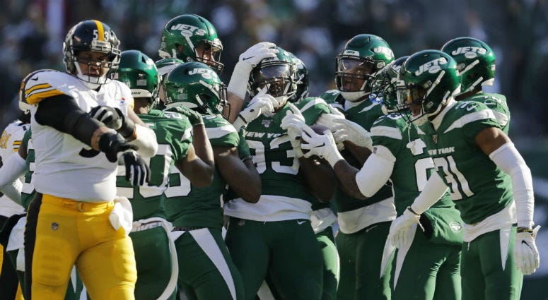 New York Jets linebacker Tarell Basham (93) celebrates an interception with teammates in the first half of an NFL football game against the Pittsburgh Steelers, Sunday, Dec. 22, 2019, in East Rutherford, N.J.