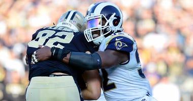 Rams linebacker Alec Ogletree brings down Saints tight end Coby Fleener on Nov. 26, 2017, at Los Angeles Memorial Coliseum.