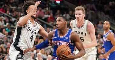 Knicks forward RJ Barrett drives in against Spurs guard Derrick White on Oct. 23, 2019, in San Antonio.