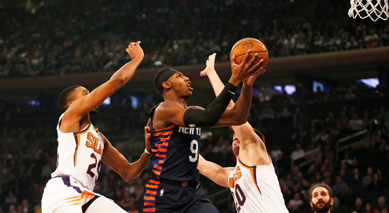 Knicks guard RJ Barrett goes up for a shot between the Phoenix Suns' Mikal Bridges and Dario Saric (20) on Jan. 16, 2020, at Madison Square Garden.