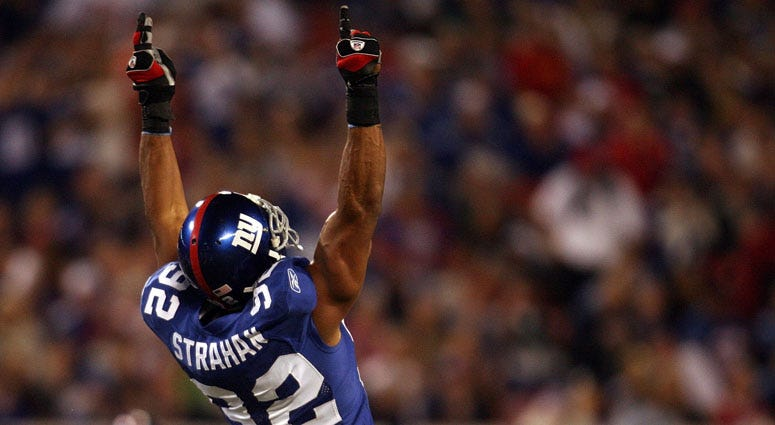 Michael Strahan celebrates after becoming the Giants' all-time sack leader against the Philadelphia Eagles at Giants Stadium on Sept. 30, 2007.