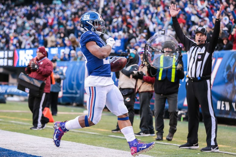 East Rutherford, NJ, USA; New York Giants running back Saquon Barkley scores a rushing touchdown during the second half against the Miami Dolphins at MetLife Stadium on Dec 15, 2019.