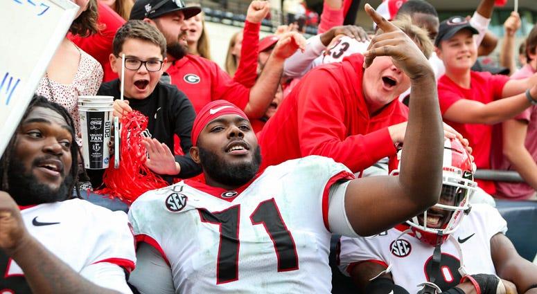 Georgia's Andrew Thomas celebrates after a win over Georgia Tech on Nov. 30, 2019, at Bobby Dodd Stadium in Atlanta.