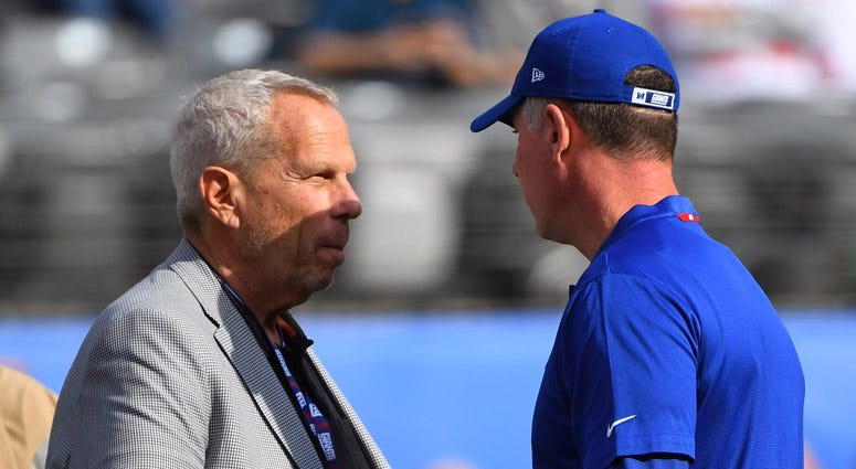 Giants Chairman Steve Tisch talks with coach Pat Shurmur before their game against the New Orleans Saints on Sept. 30, 2018, at MetLife Stadium.