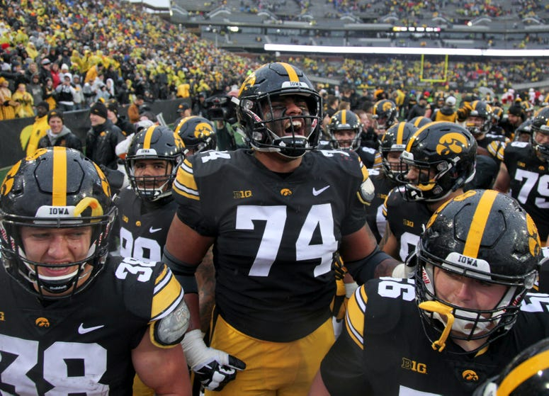 Offensive lineman Tristan Wirfs of the Iowa Hawkeyes celebrates with teammates after their match-up against the Nebraska Cornhuskers on November 23, 2018 at Kinnick Stadium, in Iowa City, Iowa.