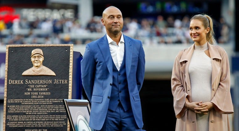 Former New York Yankees shortstop Derek Jeter and his wife Hannah look on during a ceremony to retire his jersey number and unveil his monument to be placed in monument park before the game against the Houston Astros on May 14, 2017 at Yankee Stadium.
