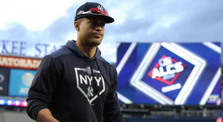New York Yankees left fielder Giancarlo Stanton (27) walks off the field after fielding balls in the outfield during batting practice before game four of the 2019 ALCS playoff baseball series on Oct 17, 2019 against the Houston Astros.
