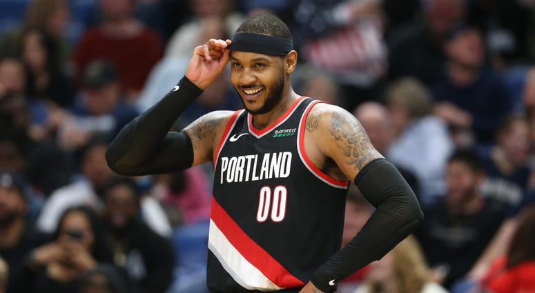 Portland Trail Blazers forward Carmelo Anthony smiles in the second half against the New Orleans Pelicans Nov 19, 2019; New Orleans, LA